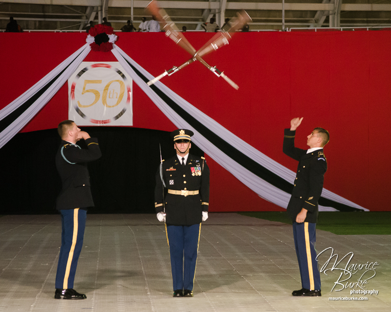 Members of the US Army's Drill Team toss rifles at the Military Tattoo to mark the 50th Anniversary of Trinidad and Tobago's Independence.